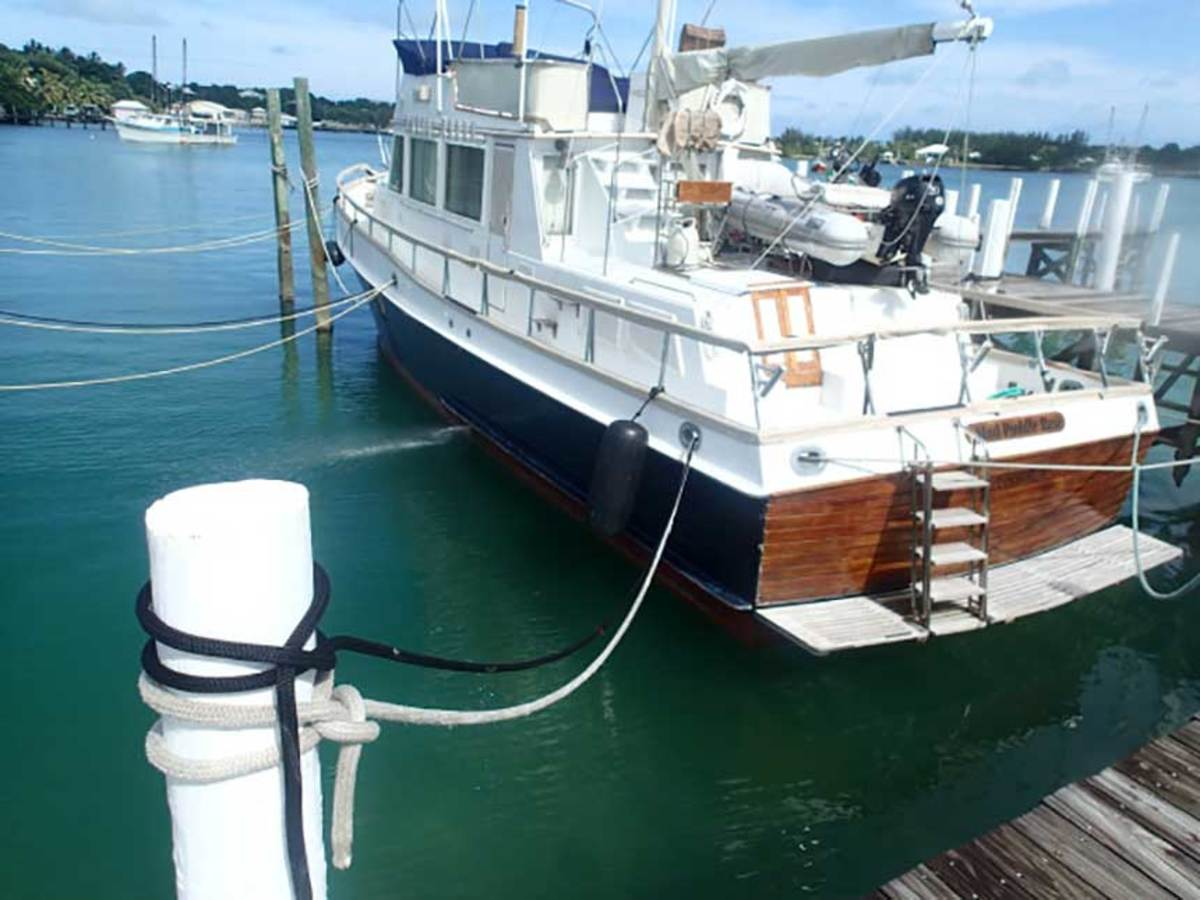 Mud Puddle Rose, the Chilbergs' Grand Banks 49, was a secured to a marina dock at Marsh Harbour with more than 1,000 feet of line.