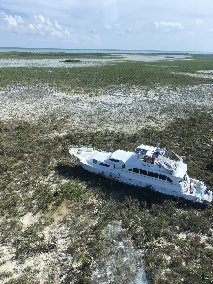 Read the story behind this image of a beached Chris Craft 82, provided to us by Nassau Helicopters.Two couples rode out Dorian on this motoryacht while anchored in Abaco waters.
