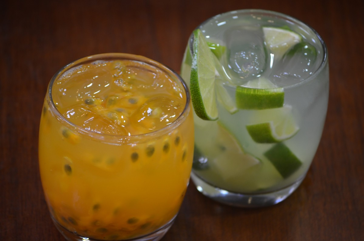 "At right is the traditional Caipirinha, made with cachaça, smashed limes and unrefined sugar. At left is a modified version, called a Jorge Amado, adding pulpy passion fruit. Jorge Amado is Brazil's most famous writer, and the cocktail named for him uses a cachaça called Gabriela, which is infused with ginger, cinnamon and cloves. Gabriela also happens to be the name of one of Amado's novels. One writer said that a Jorge Amado ""tastes like Christmas in a glass."""