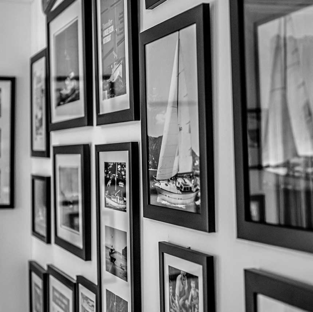 Though Deuel has only cruised three of the 15 boats Saunders has owned, she helps retell the stories of all the Tropicbirds, Travellers and other vessels whose images adorn the walls of their new home.