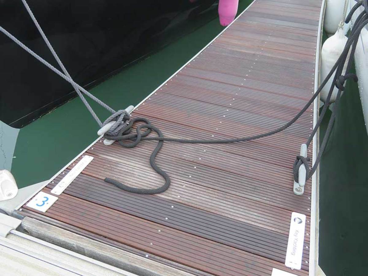 You should never take your mooring line across to the far side of the pontoon, nor should you jam up somebody else's line by adding yours to the fray.