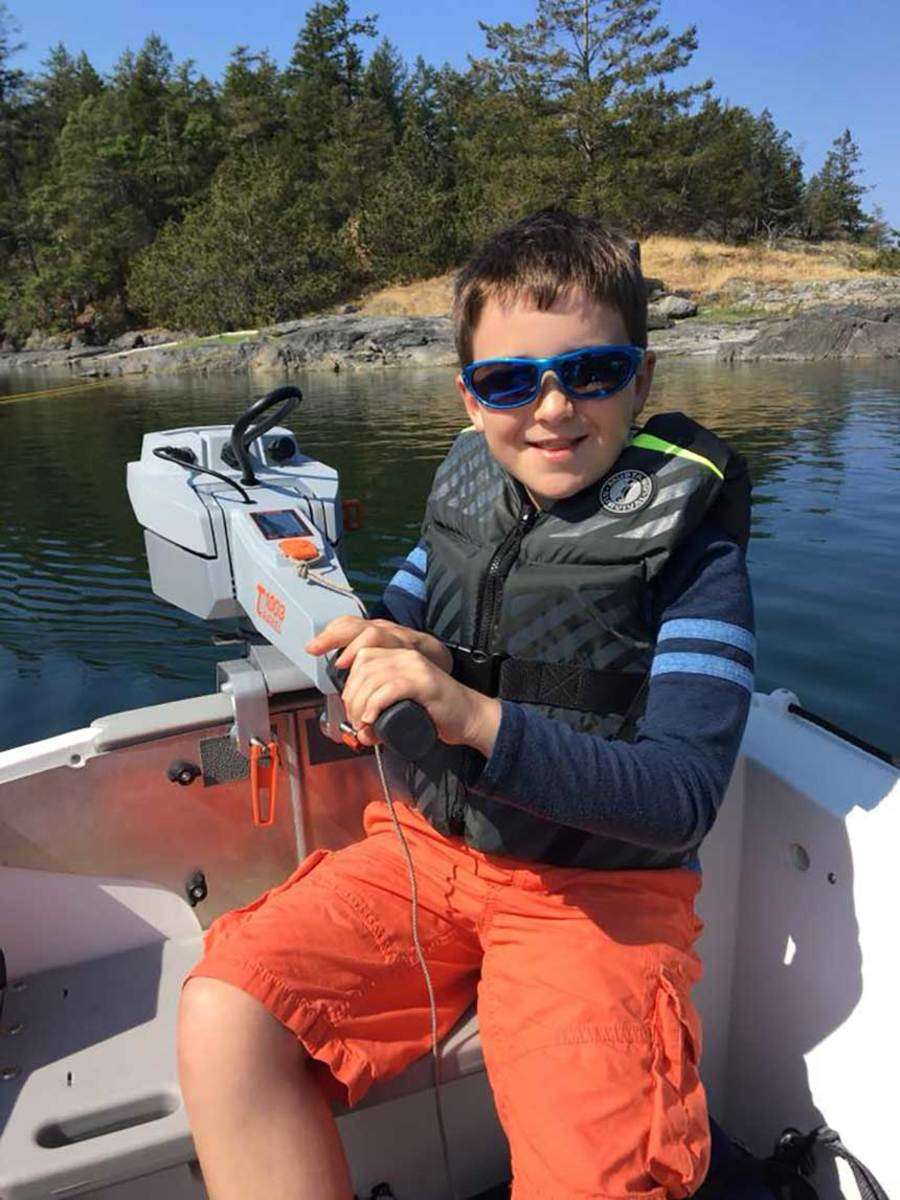 10-year-old Alec Kohn takes charge in the dinghy.