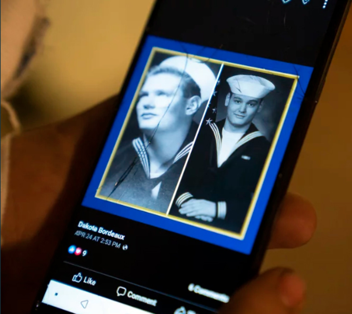 Bordeaux shows a collage on his phone of his grandfather, left, next to himself in uniform. (Nick Oxford for ProPublica)