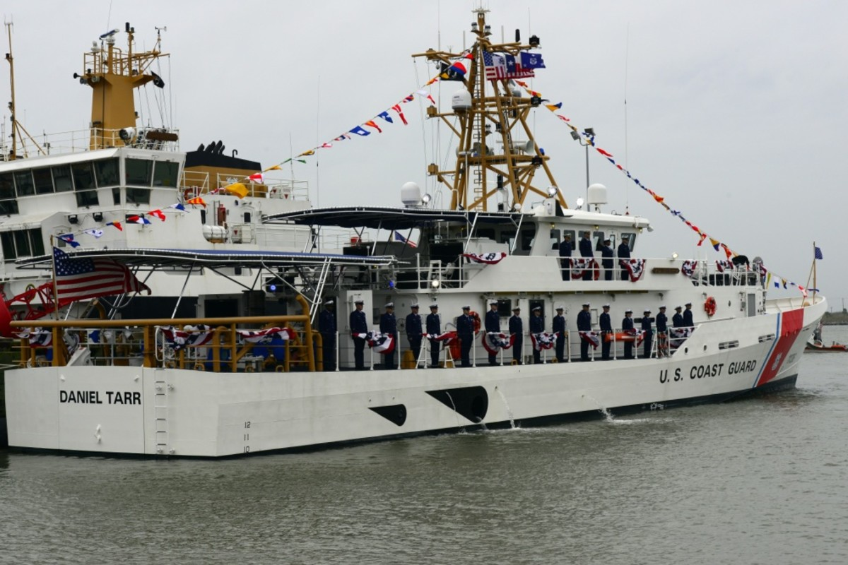 Coast Guard Cutter Daniel Tarr's crew members report for duty during the commissioning ceremony.