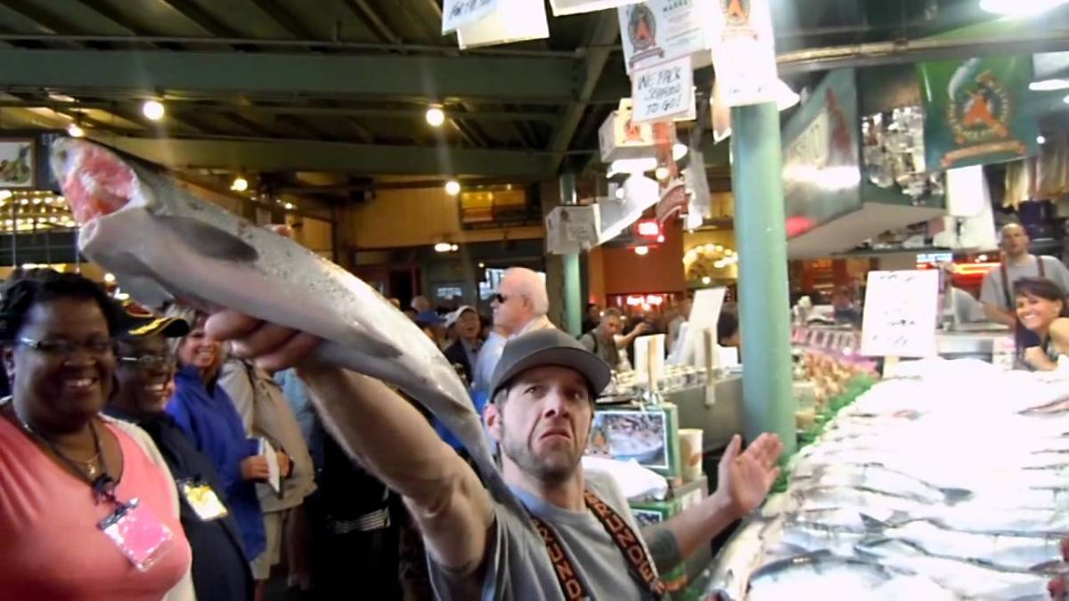 Catching a thrown fish at the Pike Place Market
