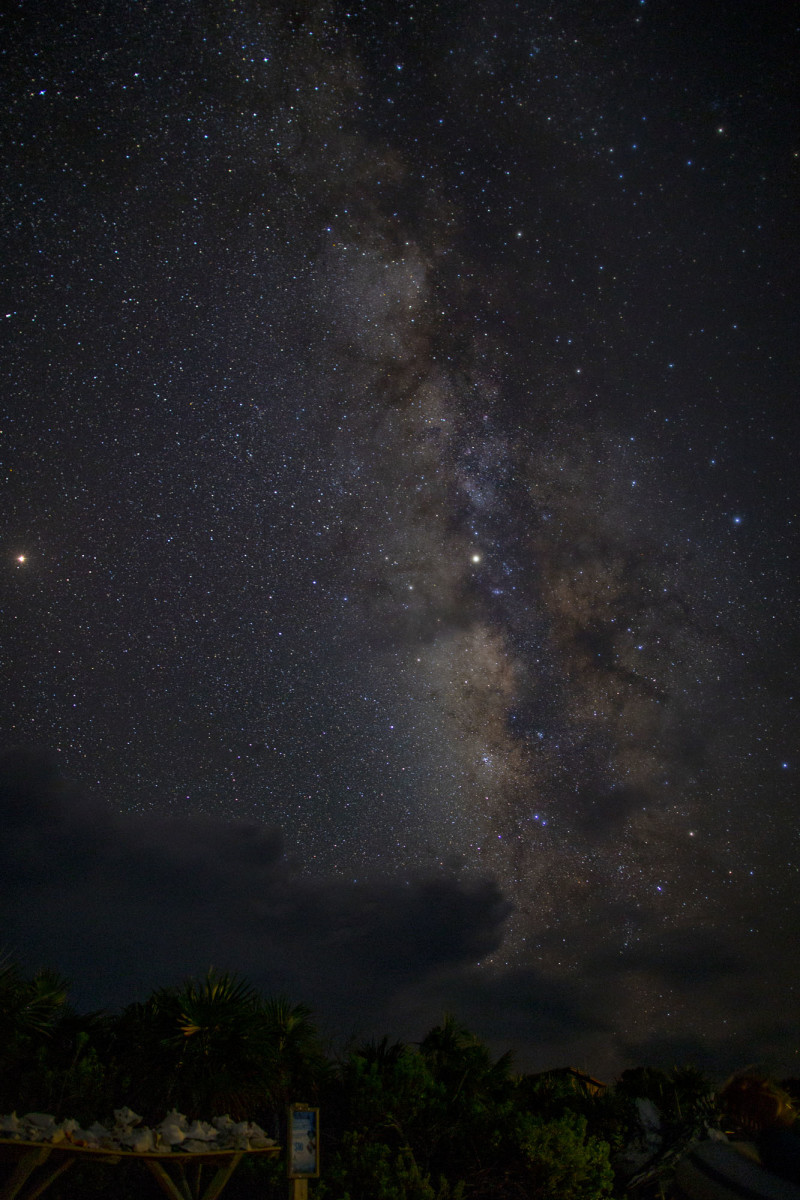 A clear shot of the Milky Way. On the far left, the red dot is Mars, the closest it would come to Earth for another 160 years.