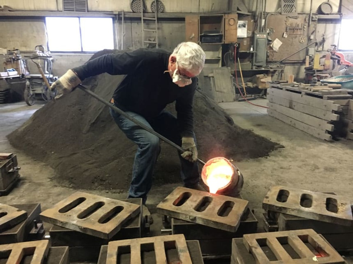 Mike Hood pours molten bronze for the final time of his 43-year career.