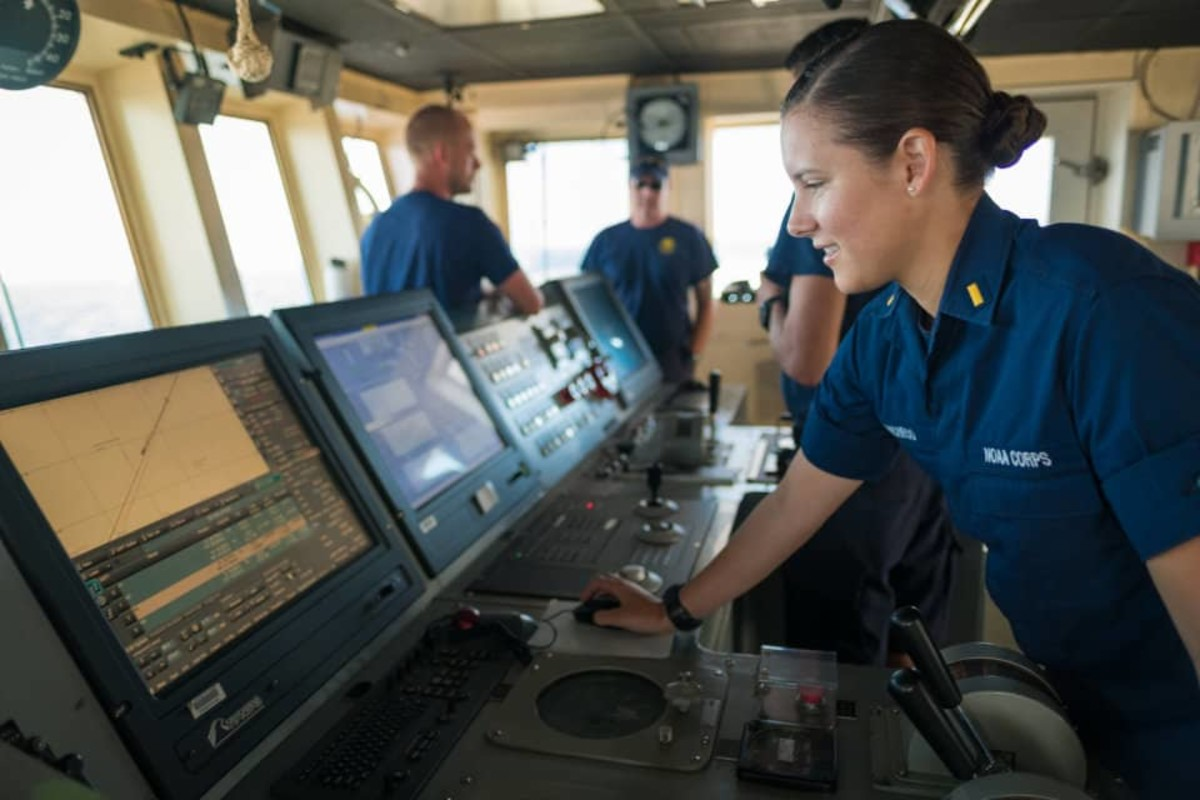 NOAA Corps Ensign Brianna Pacheco using the ship's Electronic Chart Display Information System to navigate the ship. ECDIS is a navigation app that includes electronic navigation charts and other tools.