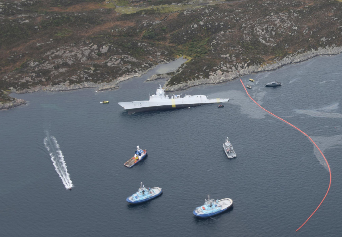 Norwegian warship Helge Ingstad ran aground and sank in shallow water after a collision with oil tanker Sola TS.