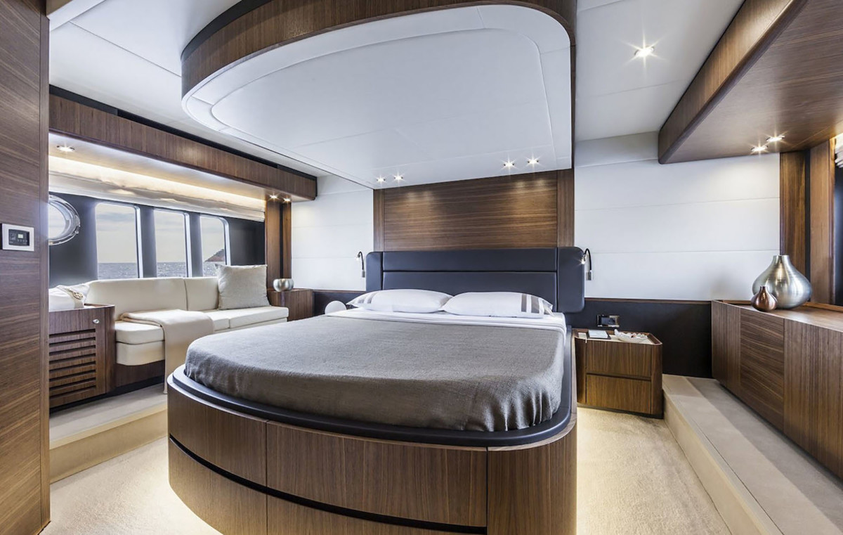The master suite on the Absolute Navetta 58 features multiple hull-side windows for light and significant ventilation.