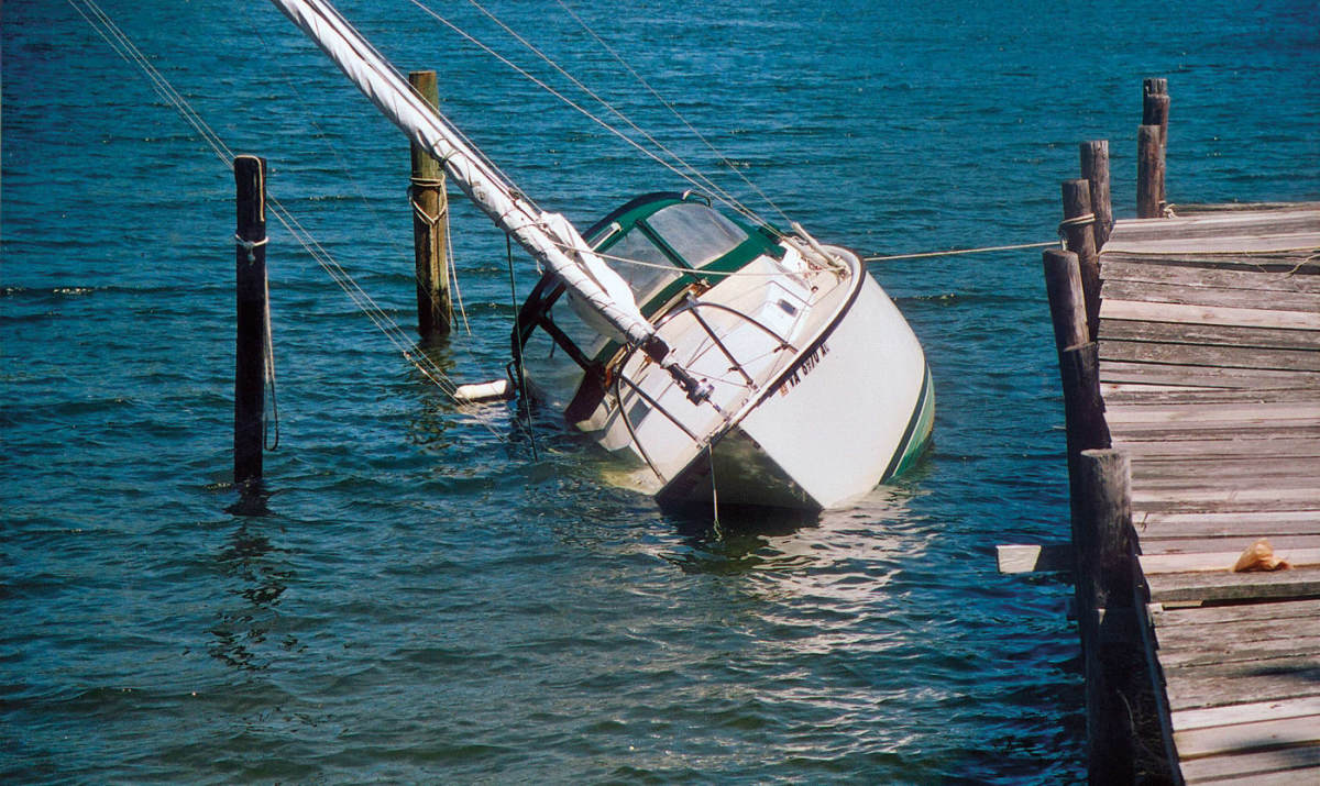 A leaky hose was all it took to send this boat to the bottom at her slip.