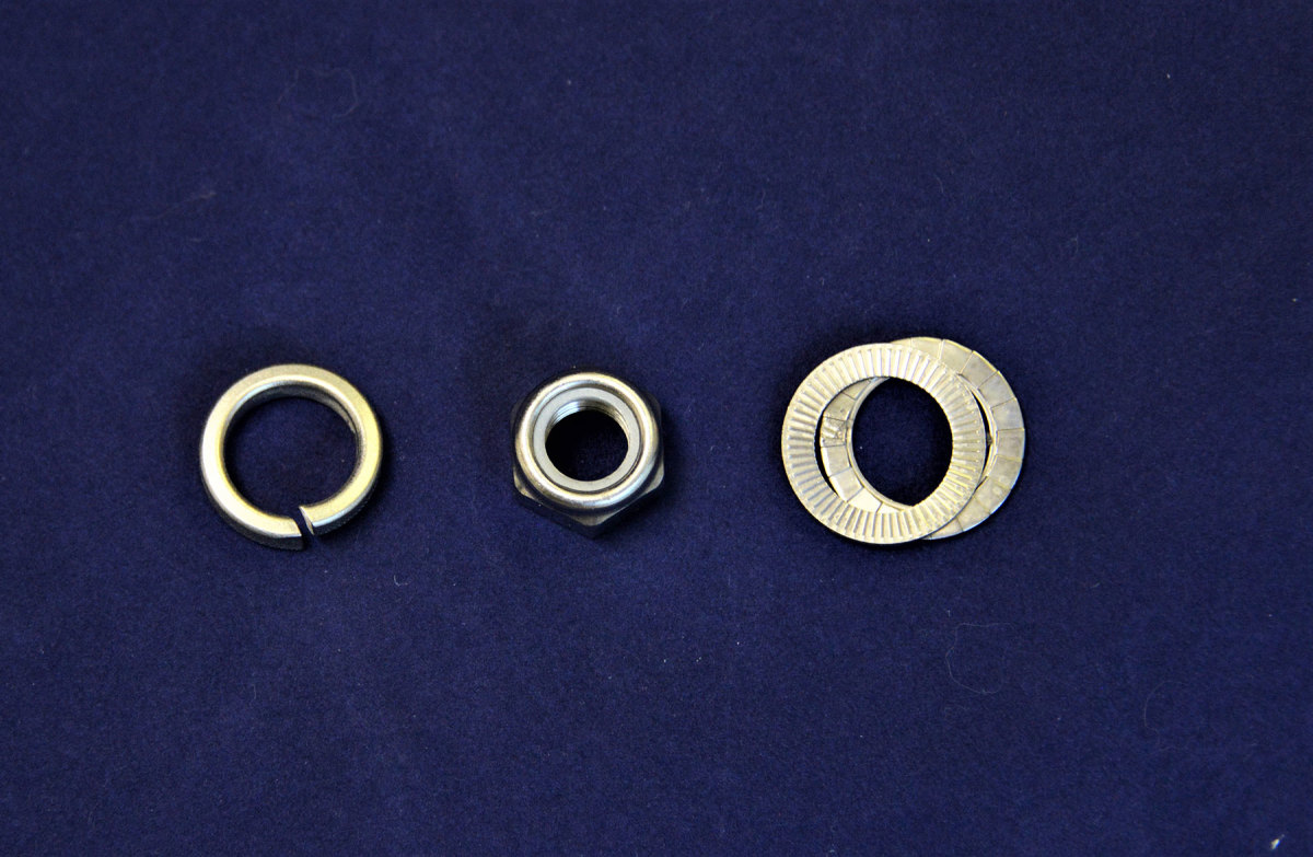 The lock washer on the left offers questionable holding power. The nylon insert nut in the middle holds much better and the Nord-Lock washers on the right provide the best holding power.