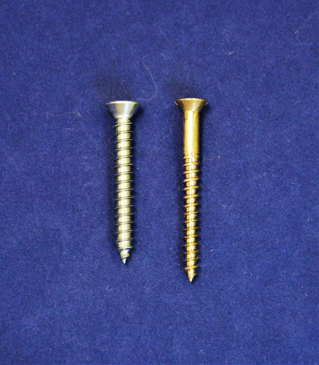 The self-tapping screw on the left has a uniform shank width and can use a standard drill bit for the pilot hole. The wood screw on the right is tapered and requires a tapered drill bit.