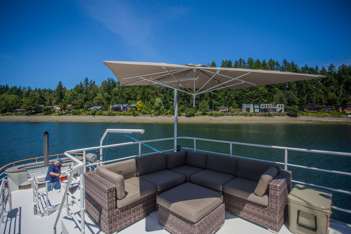 With canvas cover deployed, the flybridge lounge makes an inviting seating area