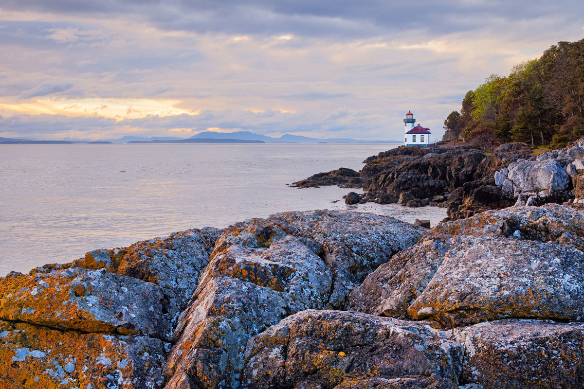 Watching over the whales at the entrance to Haro Strait, the historic Lime Kiln Lighthouse on San Juan Island borrows its name from the lime kilns built in the area in the 1860s.
