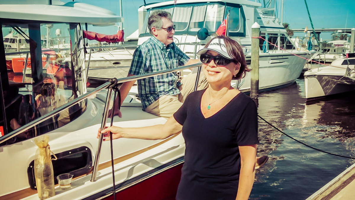 Jim and Lisa Favors, and their newly christened R-29 Kismet in Fort Myers, Florida