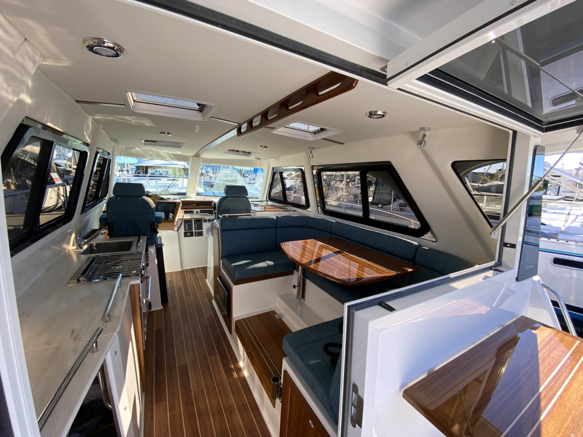 A little bit of extra beam creates a comfortable interior with a C-shaped Dinette. Opening doors and windows means a convenient connection to the cockpit.