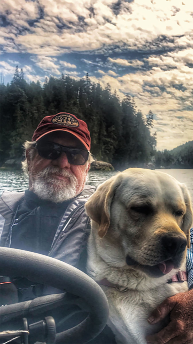 Passagemaker reader Jim Patterson, of the Grand Banks 36 Gypsea, with first-mate Finnegan, an English lab.