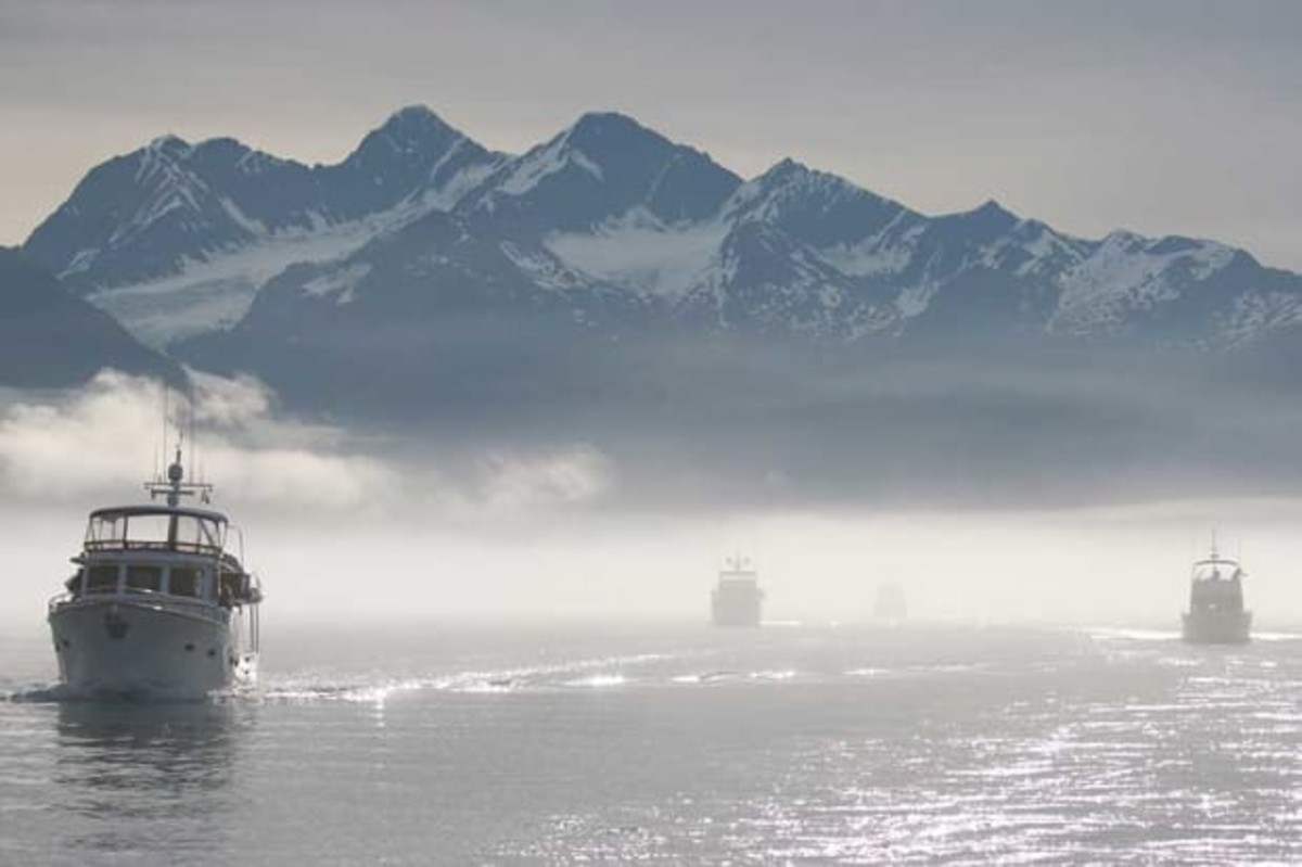 Routine fog and 20-foot tidal swings in Alaska are reasons why bareboat clients of Northwest Explorations are signing onto captain-led flotillas.