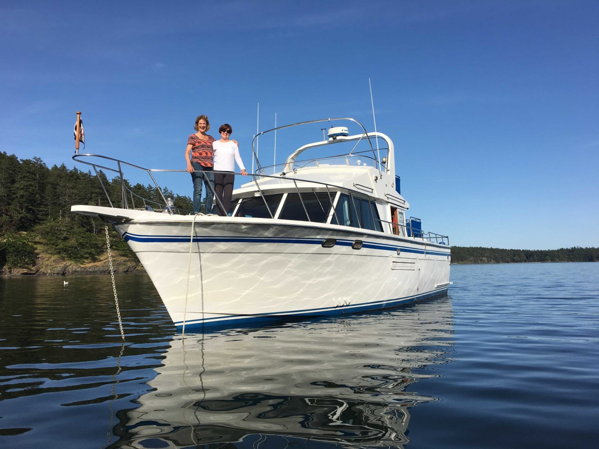 The classic 40-foot DeFever Caliente looks quite comfortable in Westcott Bay, San Juan Islands, as do guests Cathy and Vanita.