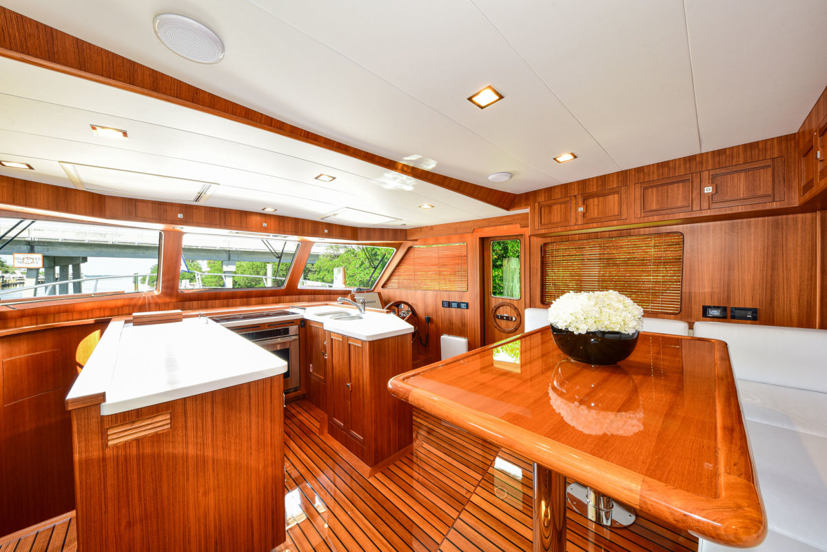 The Marlow 58E Hull No. 16, with her lower helm to starboard of the country kitchen-style galley