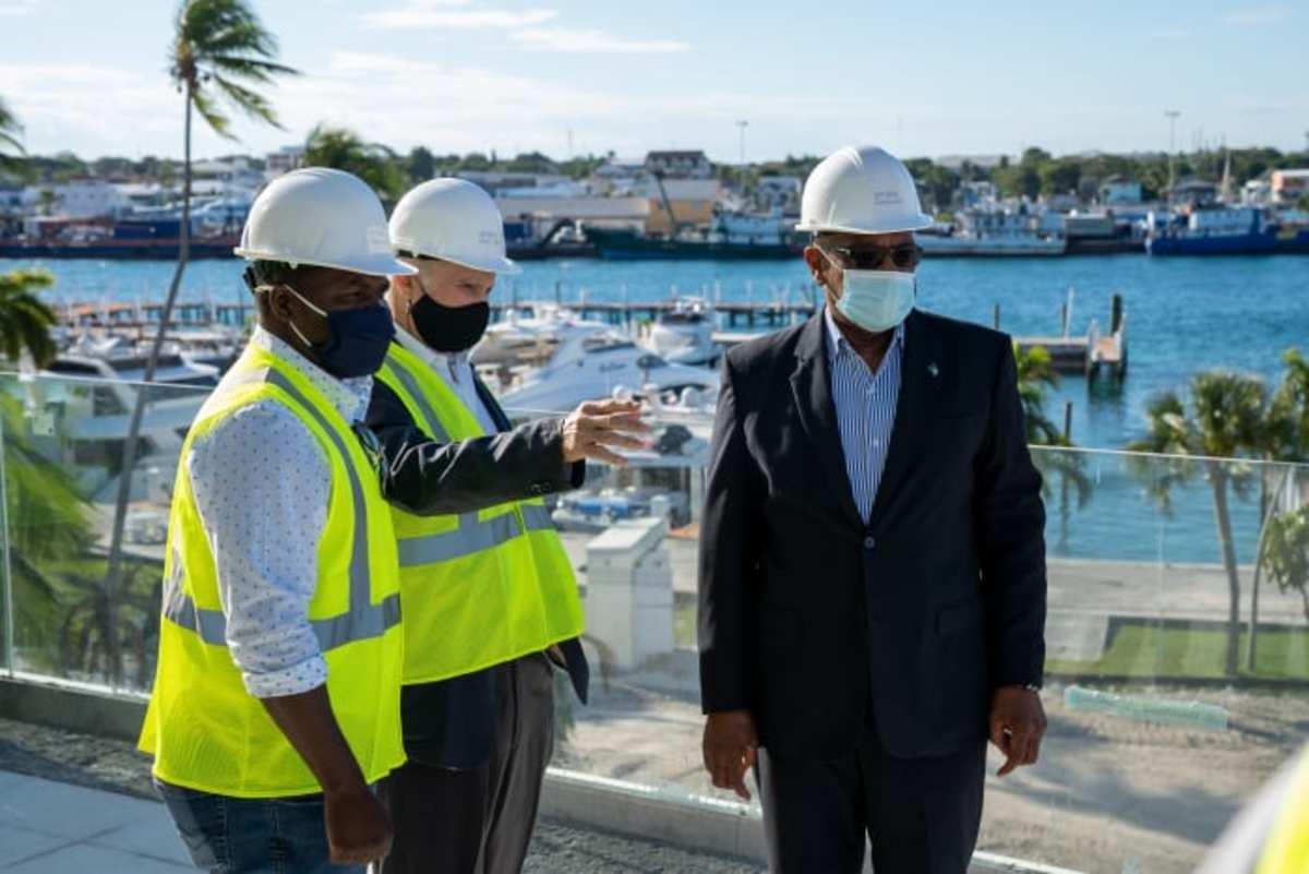 Prime Minister Hubert Minnis (right) tours Hurricane Hole Superyacht Marina at Paradise Landing.