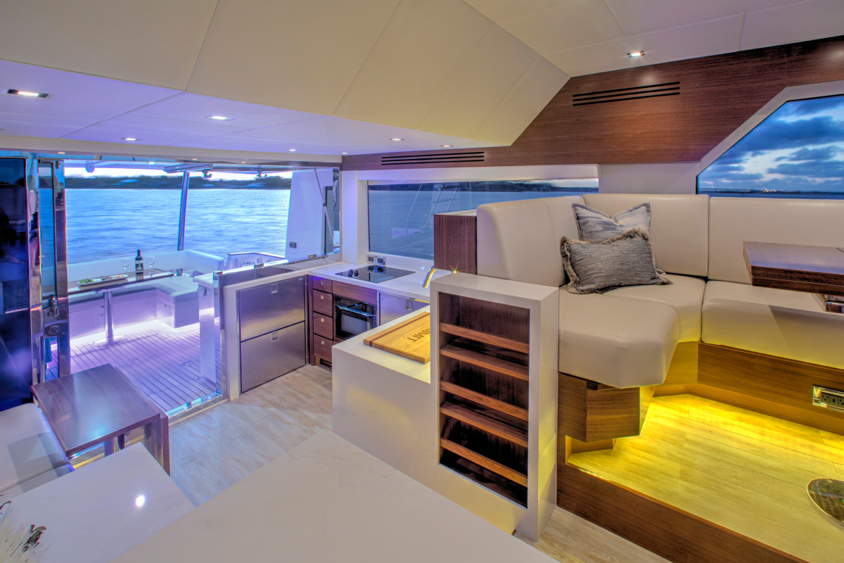 The Summit 54 encourages access to the outside, while appealing gathering points, such as the galley lounge, take the place of a traditional salon.