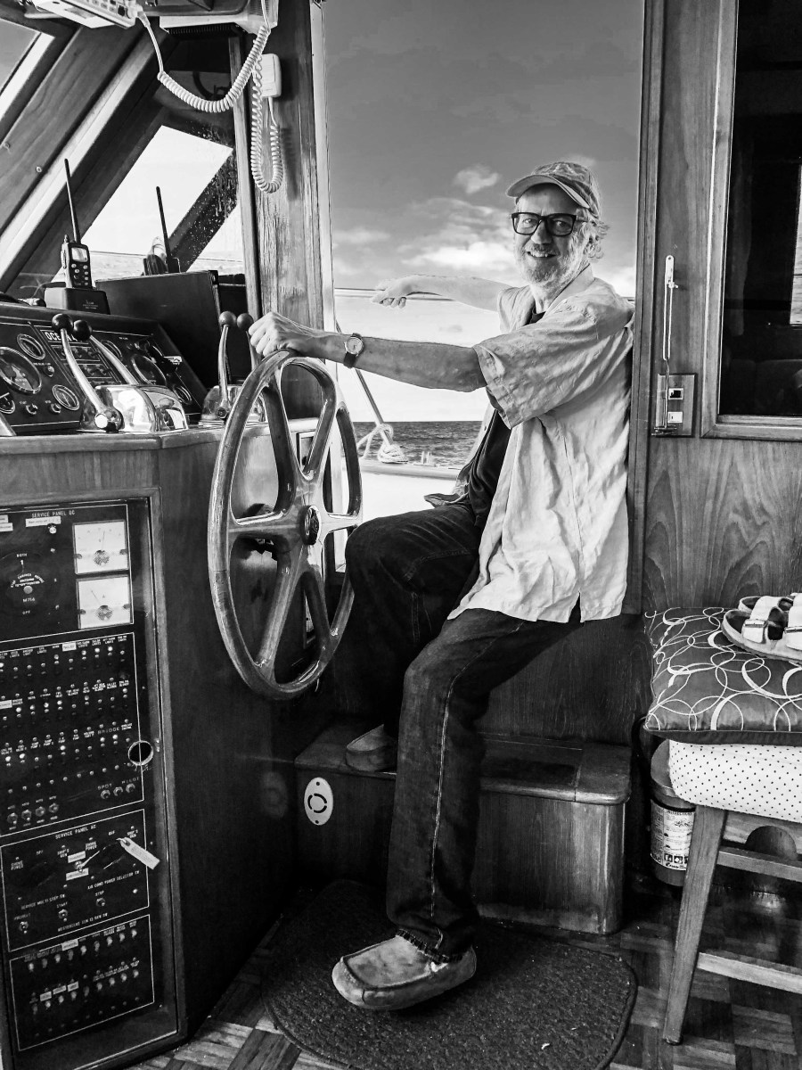 The author at the helm of his 1985 Ocean Alexander 43 Double Cabin trawler, Lazy W