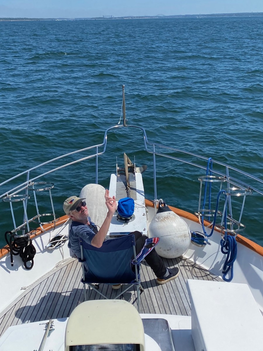 "The author enjoying his new ""sister in arms"" from the foredeck."