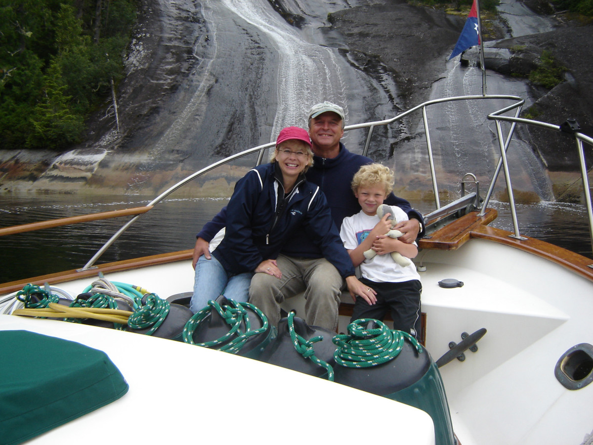 "The Parmentier family aboard their Island Gypsy ""Danny Boy"" in the PNW"