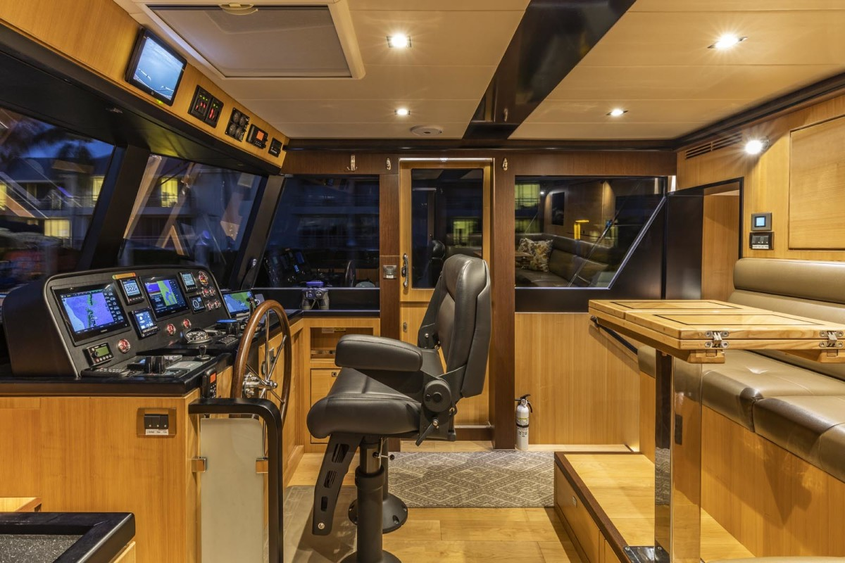 Forward raked windows add significant volume to the pilothouse.
