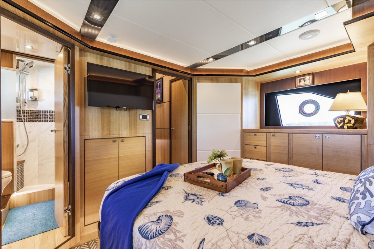 Located amidships, the full-beam master stateroom evokes a sense of modern elegance. The ensuite head has a large separate shower.