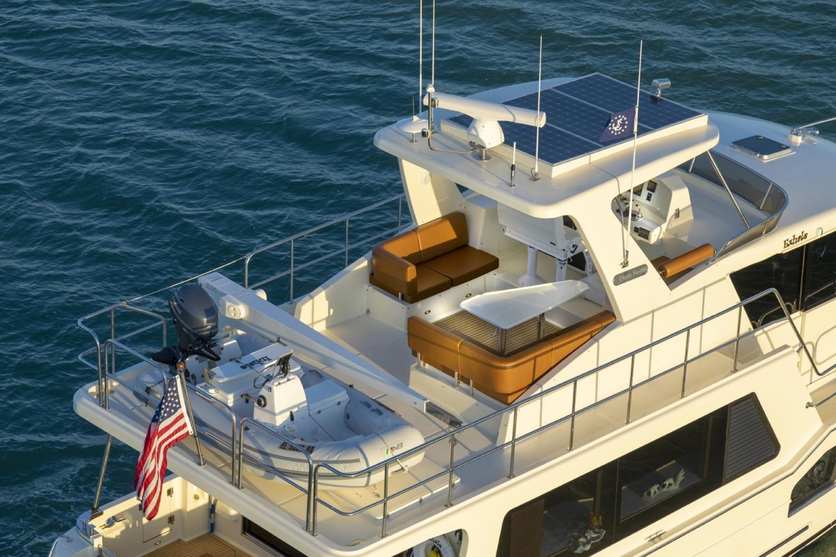 The flybridge accommodates a large family, with room to spare for dinghy and davit.