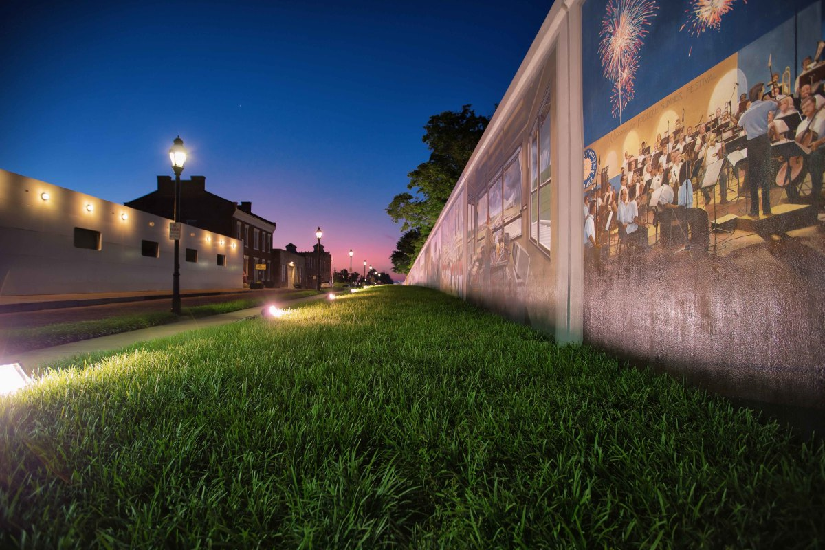 The city's floodwall is the canvas for am expansive array of history-oriented murals