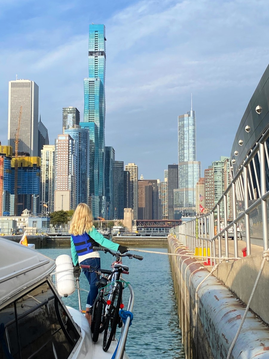 Mary Grace Bowlin handles the lines while locking into downtown Chicago aboard the family's Cruisers 4450 Motor Yacht Light & Salty.