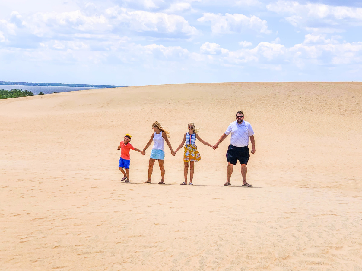 The Bowlin family explores sand dunes at Jockey's Ridge State Park in North Carolina.