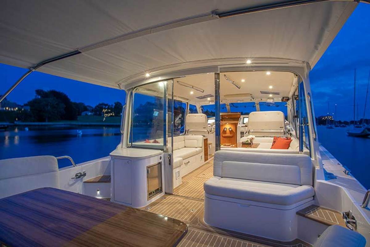 Complete with side boarding doors, the open, flush-deck design allows guests to move easily around the helm and cockpit areas, and out onto the dock within seconds.