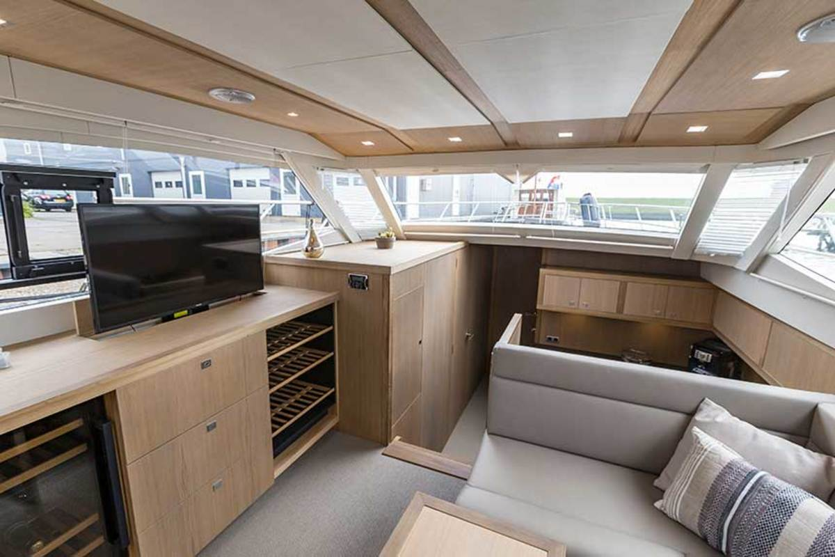 The A500 offers a customizable layout. Hull No. 1 keeps it simple with a modern minimalist interior brightened by large windows and light oak cabinetry.
