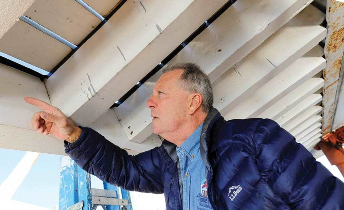 Preservation foreman John Potvin points out a new beam that was recently fitted to the lighthouse. (Photo by Gary Reich)