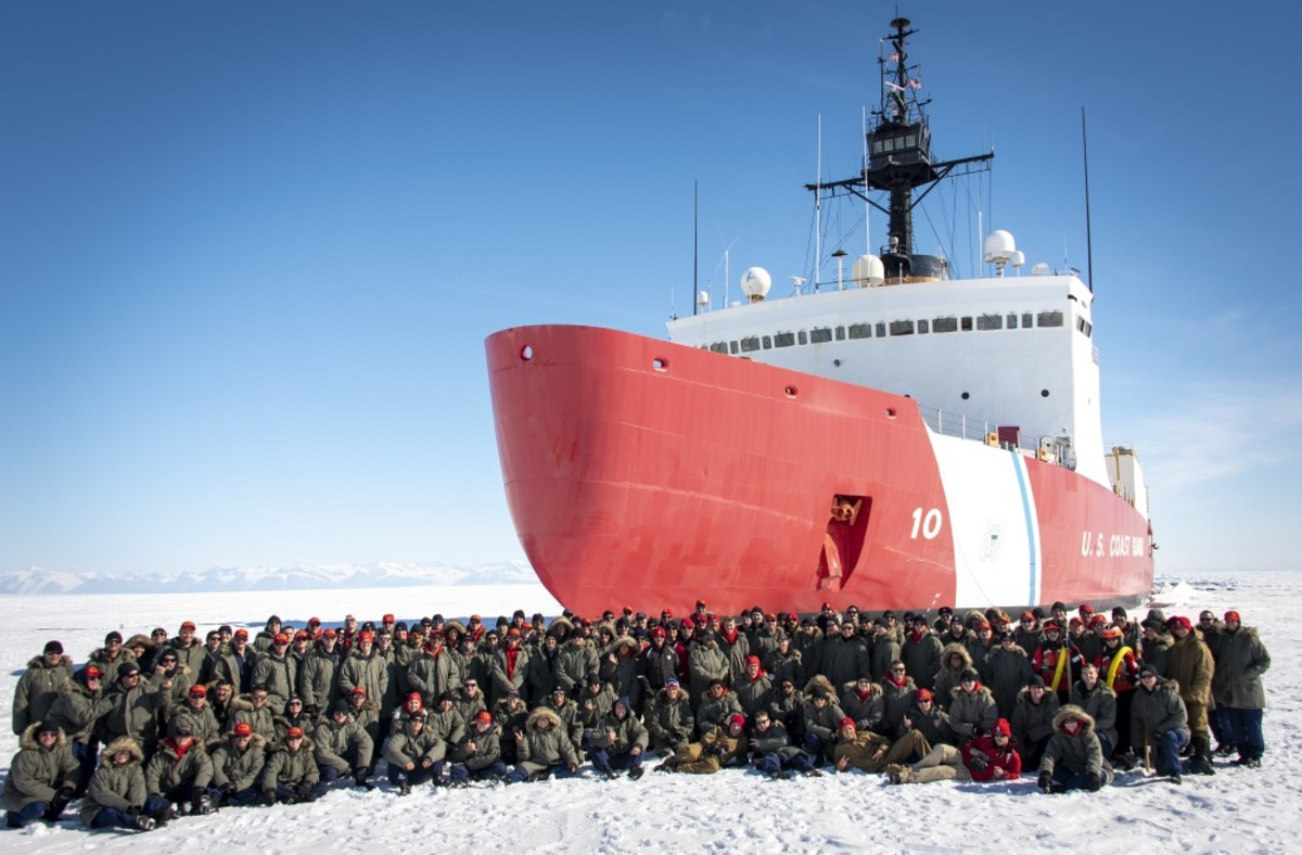 The crew of the U.S. Coast Guard Cutter Polar Star (WAGB-10) poses for a group photo Jan. 2, 2020, about 10 miles north of McMurdo Station, Antarctica. U.S. Coast Guard photograph by Senior Chief Petty Officer NyxoLyno Cangemi.