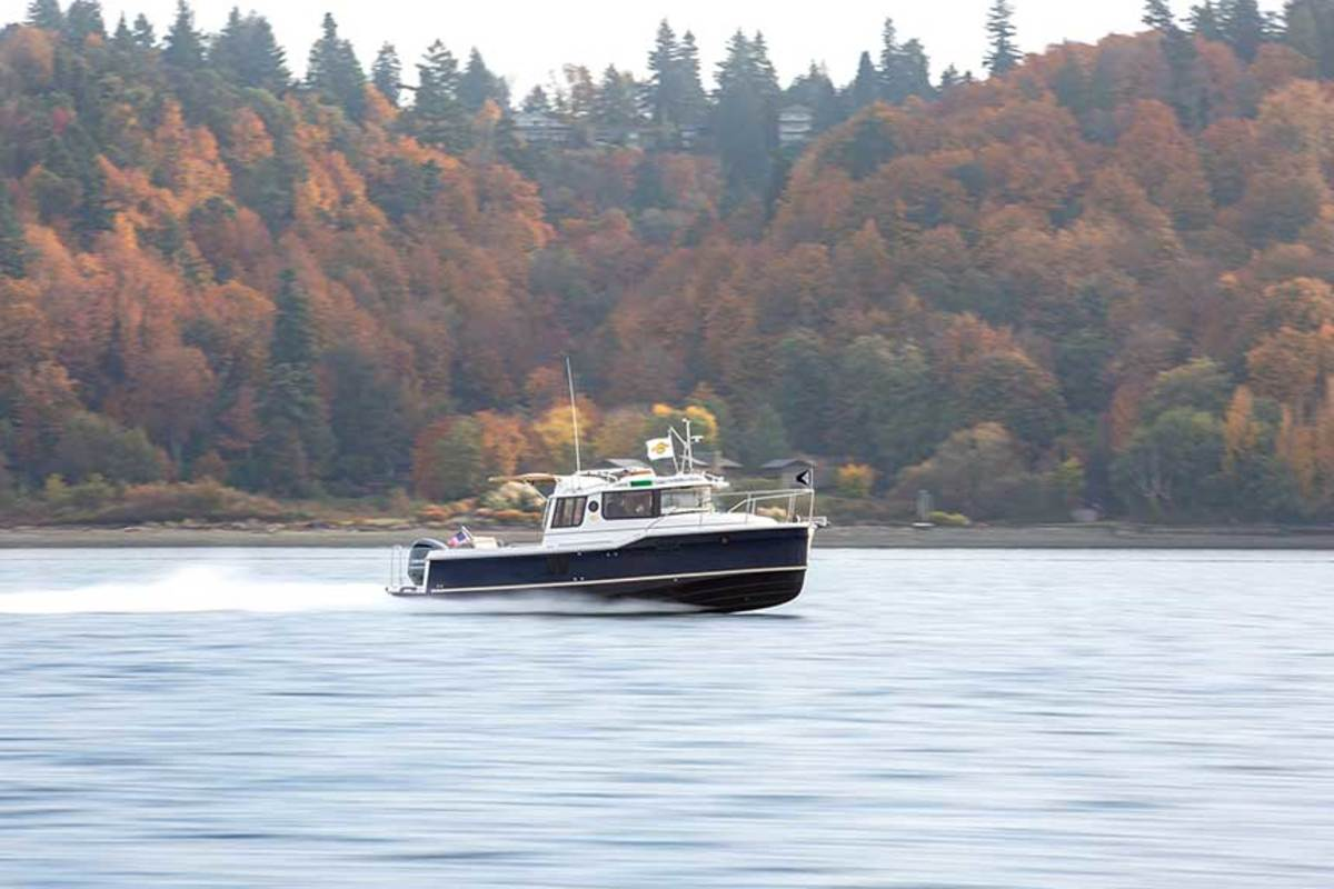 Fast and efficient, the Ranger Tugs R-25 Yamaha engine package complements her planing hull.