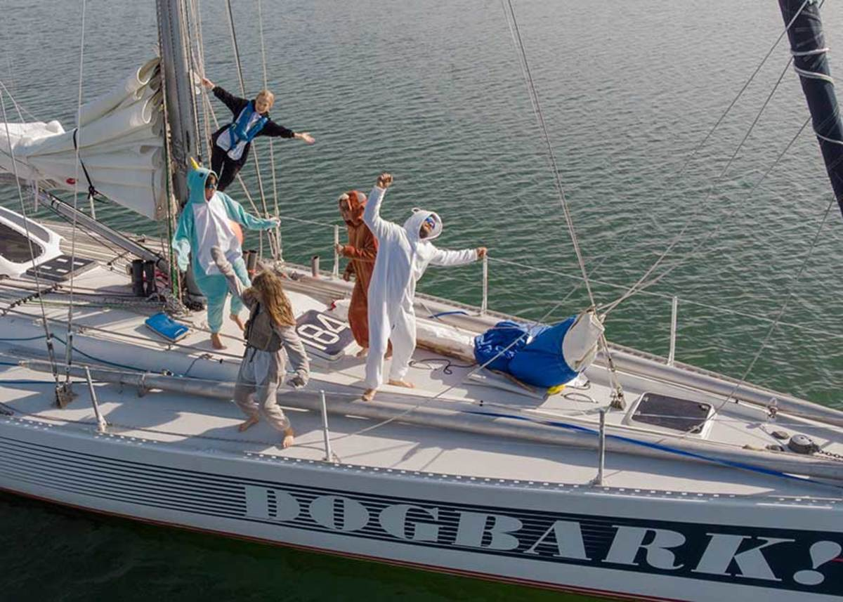 The DogBark! crew celebrates crossing into the Arctic Circle for the first time, paralleling the early whalers' routes.