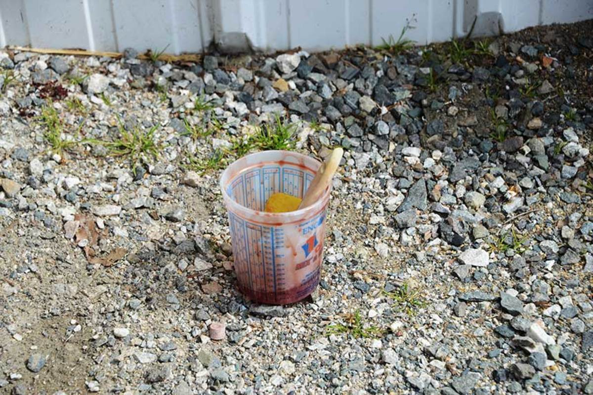 A common boatyard sight: excess resin in a cup left outside overnight. A container with catalyzed resin can generate enough heat to start a fire, and for that reason, we always leave them outside of the shops overnight. In the morning, before tossing it away, check to make sure the resin cured properly.