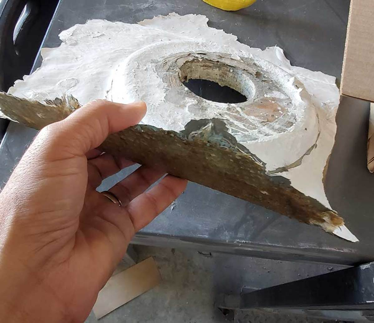 Polyester resin does not bond reliably to cured polyester. This part popped loose from the hull due to a failed bond, as a result of a poor resin choice and poor preparation.