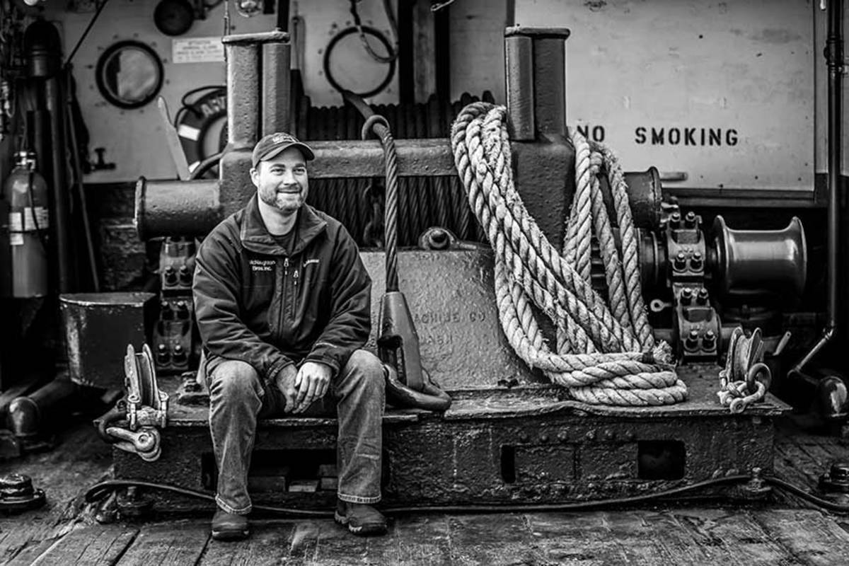 Marine archaeologist Saxon Bisbee is  leading the charge to restore the Arthur  Foss. Here, he takes a break on the deck with  afternoon tugboat painting ahead of him.