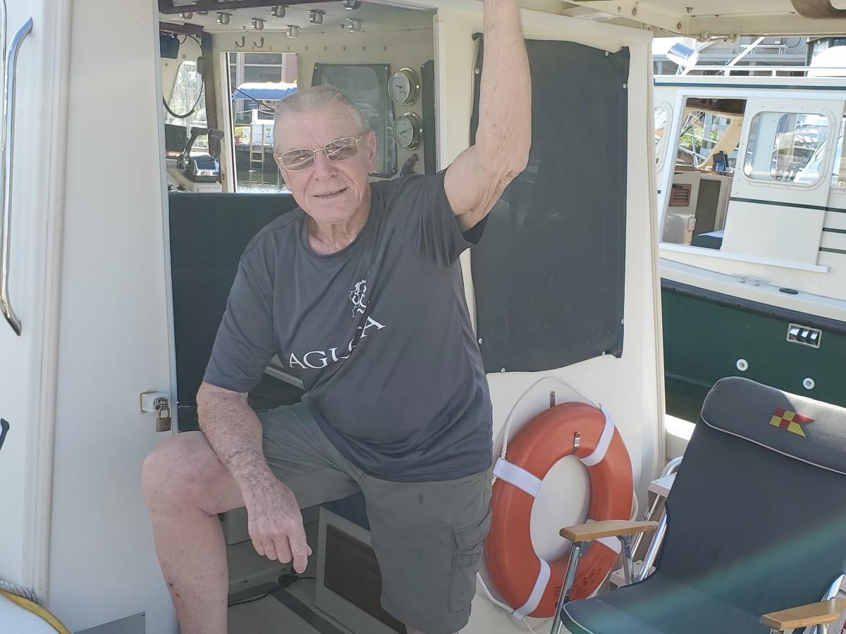 """John Hauck aboard """"Grumpy"""""""