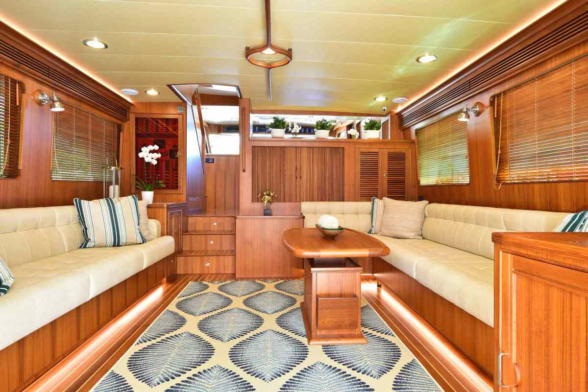 Rich teak veneer is used on the walls, coffee table and cabinets, along with teak and holly soles. Each yacht's woodwork can be harvested from a single tree, so grains match and natural resources are protected.