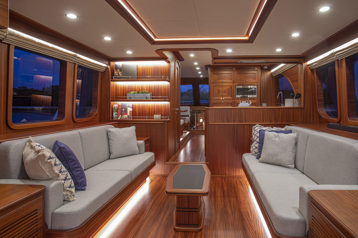 Handcrafted mahogany rules the day on the main deck, the weatherproof social center of the boat.