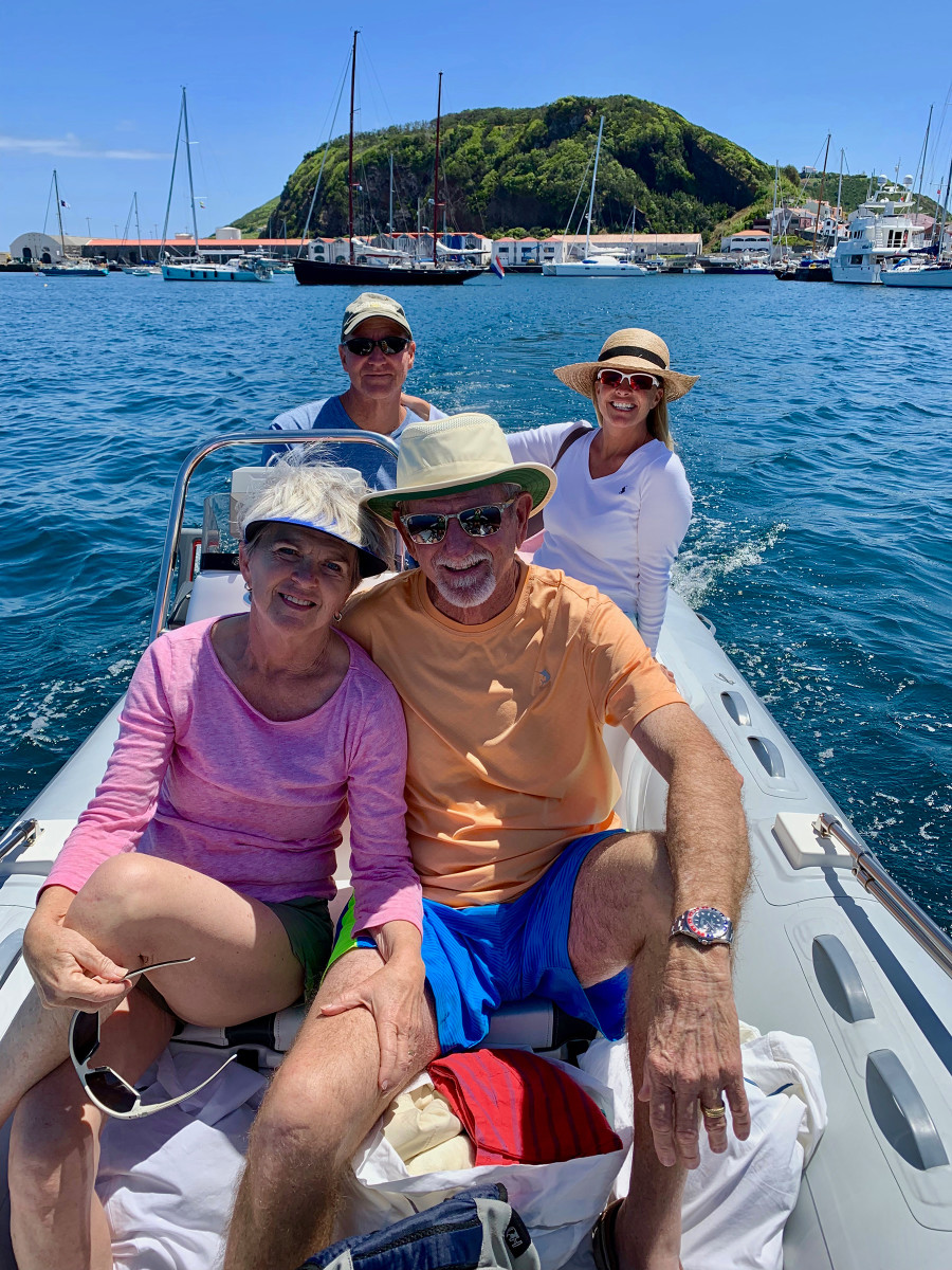 "Alec and Laurie Thyrre (aft), and Sally and Michael Hastings (forward) explore the harbor in the ""family car."""