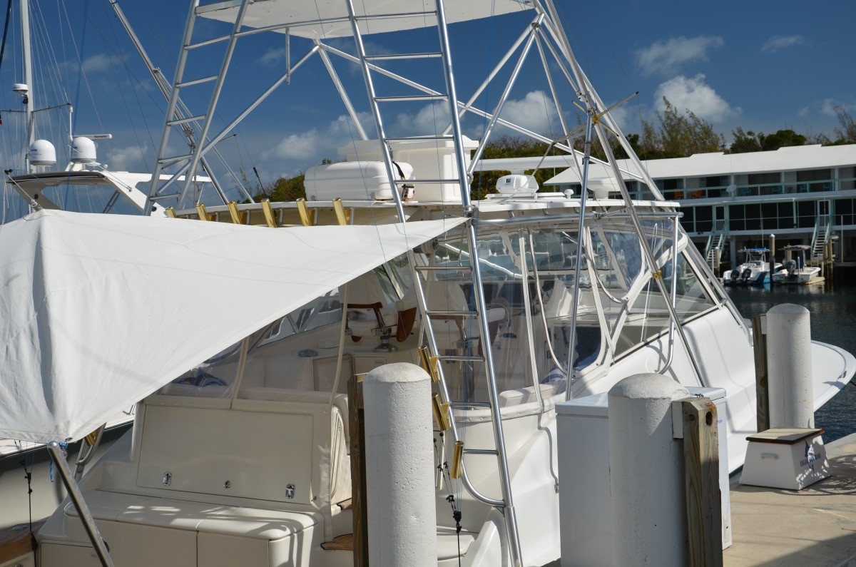 Here's a raft mounted on the roof of a smaller boat. This position is acceptable. Because of the boat's design, the mounting location is not too high, and there is a decent ladder to reach it. Once it's out of the cradle, it should not be too difficult to slide it laterally (to port or starboard), where it will go over the side.